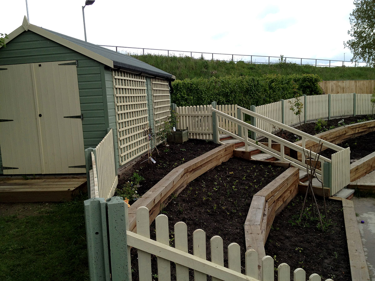 school-sloped-staging-and-garden-norwich